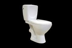 Toilet bowl. White toilet bowl on a black background Stock Photos
