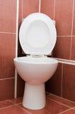 Toilet bowl in a bathroom. White toilet bowl in a bathroom Royalty Free Stock Photo