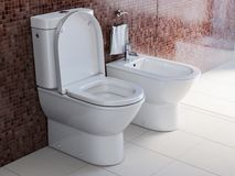 Toilet bowl and bidet in the modern bathroom stock image