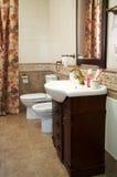 Toilet bowl, bidet and sink Stock Photos