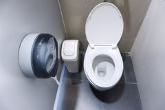 Toilet Bowl In A Modern Bathroom With Bins And Toilet Paper Royalty Free Stock Photography