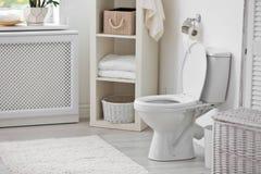 Toilet bowl in modern interior. Toilet bowl in modern bathroom interior stock photo