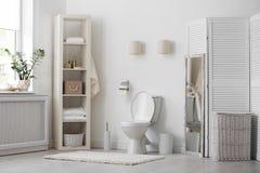 Toilet bowl in modern interior. Toilet bowl in modern bathroom interior royalty free stock photos