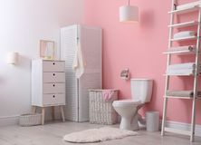 Toilet bowl in modern interior. Toilet bowl in modern bathroom interior royalty free stock photography