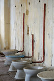 Toilet bowl in public old interior Stock Photo