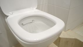Toilet Bowl is washed off by the water. Luxury bright toilet bowl is washed off by the clear water stock video footage