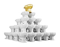 Toilet bowls pyramid. 3d pyramid of shiny ceramics lavatory pan with gold one on top Royalty Free Stock Photos