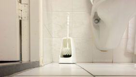 Toilet brush in a simple bathroom Stock Images