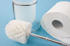 Toilet brush and toilet paper Stock Photo