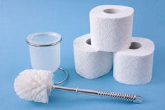 Toilet brush and toilet paper rolls Royalty Free Stock Image