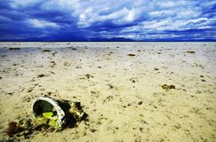 Rubbish in ocean. Toilet cistern on ocean floor with cloudy sky highlighting pollution in our oceans royalty free stock photo