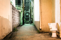 Toilet and dark alley at night in Hanover, Pennsylvania. Royalty Free Stock Photos