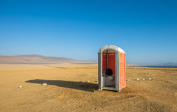 Toilet in a desert Stock Image