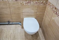 Toilet design with built-in toilet. Built-in toilet is made as an installation, all the elements, except for the toilet are hidden stock photo