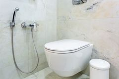 Toilet and detail of a corner shower bidet with wall mount shower attachment stock photography
