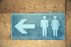Toilet direction signage Stock Photos