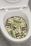 Toilet, dollars, one Stock Photo