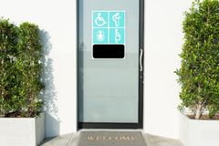 Toilet door with sign of disabled people, elderly, pregnant woma. Close up toilet door with sign of disabled people, elderly, pregnant woman, and baby for their Royalty Free Stock Photography