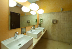 Toilet with few sinks. Interior of toilet with few sinks royalty free stock photos