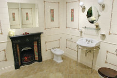 Toilet with fireplace Stock Photography