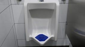 Toilet flushed inside man washroom. Close up toilet flushed inside man washroom stock video footage