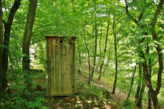 toilet in forest Royalty Free Stock Photo