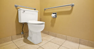 Toilet With Handicap Wall Handles. Wall handles help the disabled and handicap use the toilet with easier access Stock Images