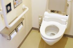 Toilet and handrail for disabled people stock images