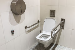 Toilet with handrails for the disabled stock image