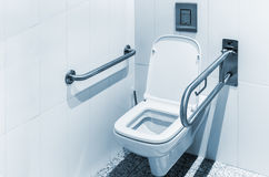 Toilet with handrails for the disabled Royalty Free Stock Photography