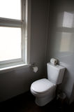 Toilet in a hotel room, home related. White toilet in a hotel room, in black and white photo Stock Photo
