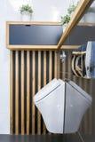 Toilet interior with urinar Stock Photo