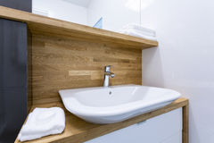 Toilet interior with wooden design Royalty Free Stock Images