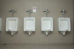 Toilet for men. Empty toilet for men with no smoking sign Stock Photos
