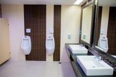 Toilet men`s room.Close up row of outdoor urinals men public toilet,Closeup white urinals in men`s bathroom royalty free stock image
