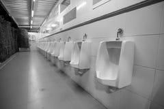 Toilet men`s room.Close up row of outdoor urinals men public toilet,Closeup white urinals in men`s bathroom royalty free stock photo