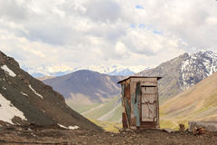 Toilet on the mountain pass Royalty Free Stock Photo