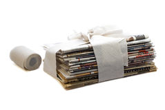 Toilet newspapers concept. Stack of newspapers wrapped in toilet paper concept Royalty Free Stock Photos