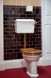 Toilet in old-fashioned style. Black wall Royalty Free Stock Photo