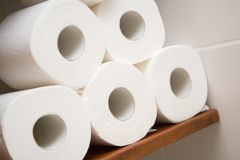 Toilet paper. Five rolls of white toilet paper in bathroom Stock Photos