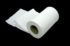 Toilet paper. On black Stock Images