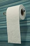 Toilet paper. Roll of toilet paper on blue striped background tiles royalty free stock photography