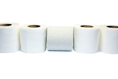 Toilet paper. One of the five rolls of toilet paper is not like the other - more grey and rough, is located in the other direction Royalty Free Stock Photos