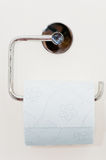 Toilet paper. On the white wall Royalty Free Stock Photo