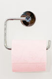 Toilet paper. On the white wall Royalty Free Stock Photography