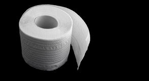 Toilet paper on the black background Royalty Free Stock Images