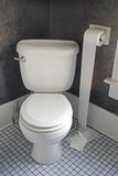 Toilet with Paper on Floor. Western toilet with toilet paper unwrapped on floor Stock Images