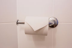 Toilet paper at hotel. Toilet paper holder. Royalty Free Stock Images