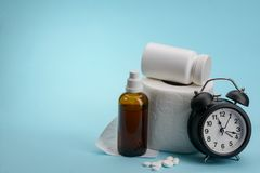 Toilet paper, medicine and clock royalty free stock photo
