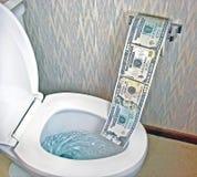 Toilet paper money in white toilet